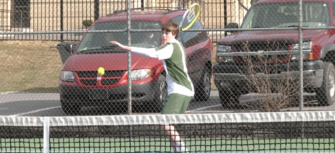 Hornet tennis sweeps Liberty for first win.