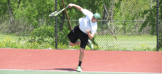 Redell competes in District tennis singles.