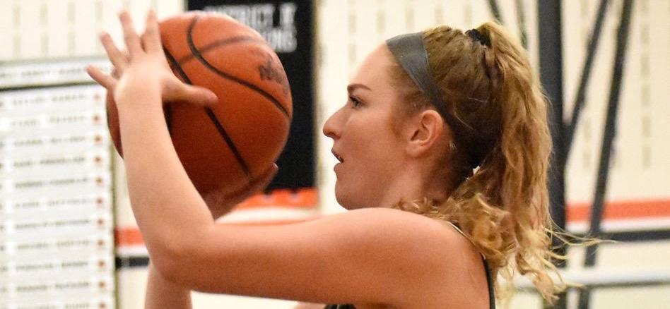 Poirier headlines All-Region basketball team.